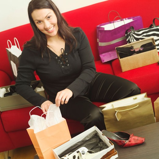 Stock Photo: 1530R-14048 A young woman trying on shoes in a store.