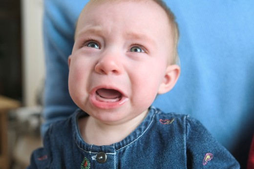 A crying baby girl. : Stock Photo