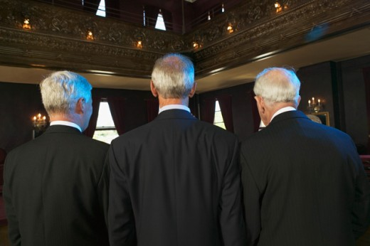 Stock Photo: 1530R-18024 Rear view of three senior men in a dance hall.