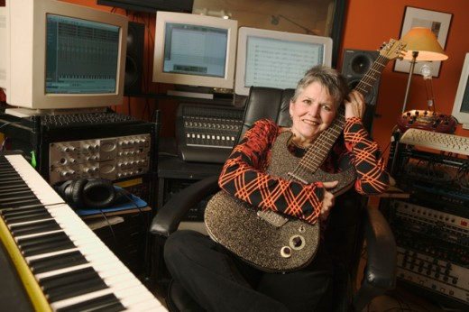 Stock Photo: 1530R-19043 Woman in a computerized recording studio.