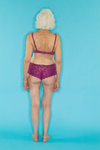 A senior woman modeling lingerie : Stock Photo