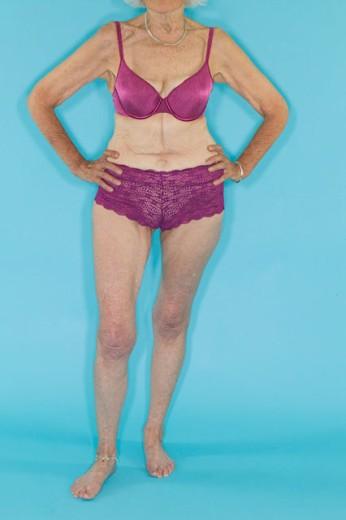 A senior woman modeling lingerie : Stock Photo