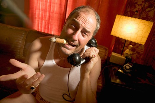 Stock Photo: 1530R-25029 A man in his underwear phoning and smoking a cigar