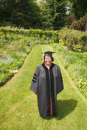 A middle aged female graduate : Stock Photo