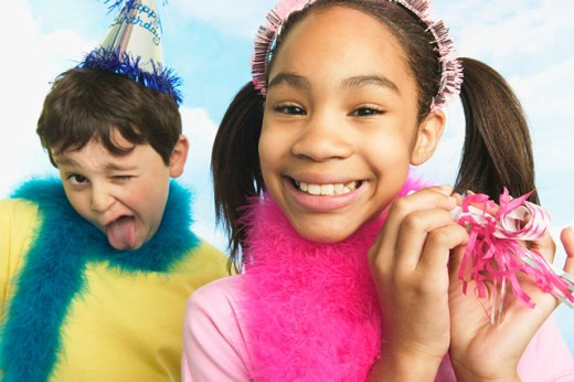 Stock Photo: 1530R-27059 Boy and girl in party hats