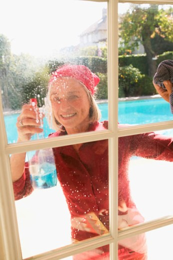 Woman cleaning windows : Stock Photo