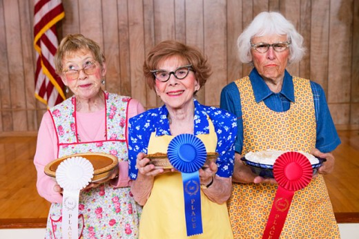 Stock Photo: 1530R-28035 Three women with prizes for homemade pies