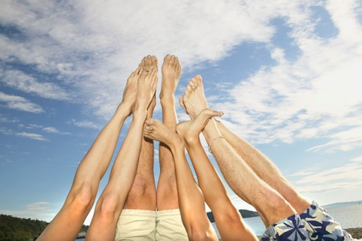 Legs and feet up in the air : Stock Photo