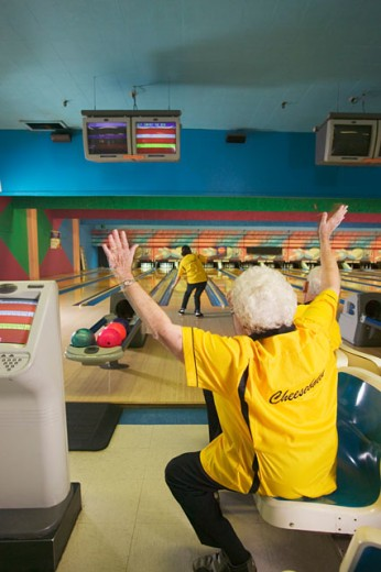 Female bowler cheering for her teammate : Stock Photo