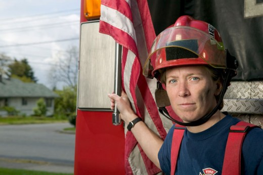 Stock Photo: 1530R-30046 Portrait of a female firefighter