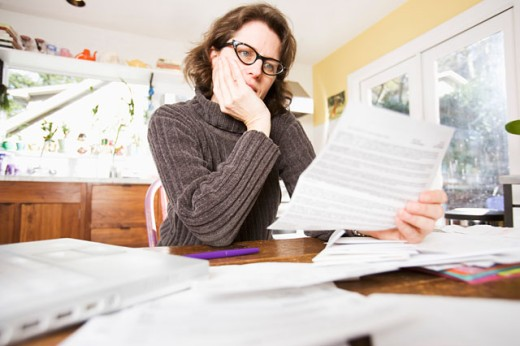 Woman reading paperwork : Stock Photo