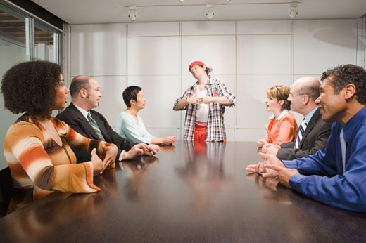 Weird co-worker at a meeting : Stock Photo