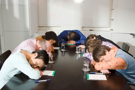 Colleagues asleep at conference table : Stock Photo