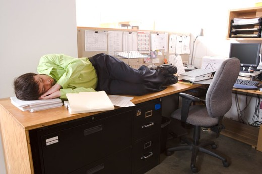 Male office worker asleep on desk : Stock Photo