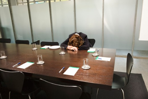 Woman asleep at conference table : Stock Photo
