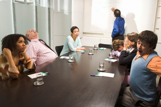 Bored and tired co-workers in meeting : Stock Photo