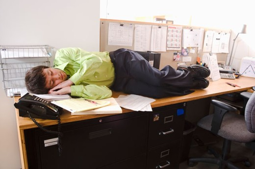 Man asleep on his desk : Stock Photo