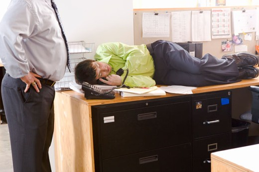 Boss discovering employee asleep on desk : Stock Photo