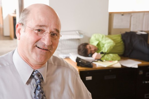 Stock Photo: 1530R-35155 Portrait of boss with sleeping employee