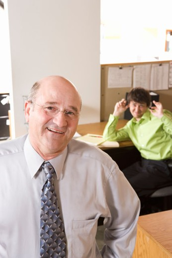 Employee making fun of boss : Stock Photo