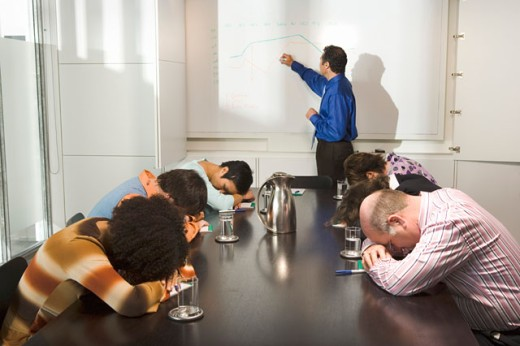 Co-workers falling asleep during presentation : Stock Photo