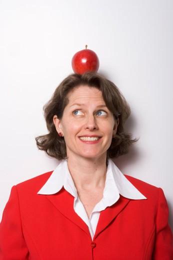 Apple sitting on businesswoman's head : Stock Photo