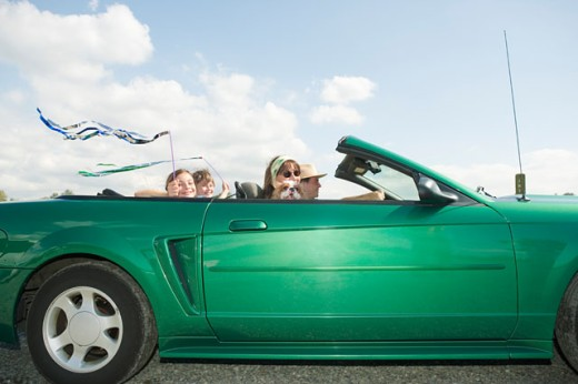 Family riding in convertible car : Stock Photo