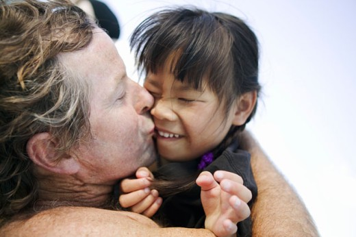 Closeup of father kissing daughter : Stock Photo
