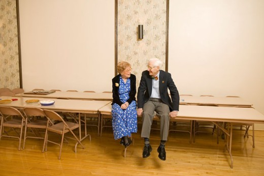 Two seniors sitting and chatting : Stock Photo