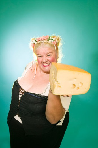Stock Photo: 1530R-35982 Woman in Germanic costume with cheese wedge