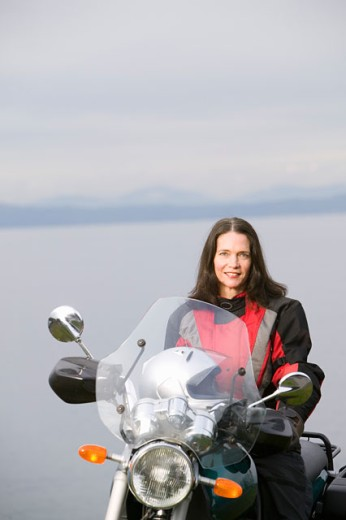 Woman posing on motorcycle : Stock Photo