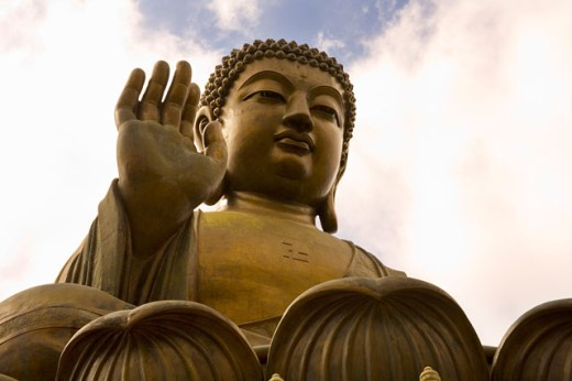 Stock Photo: 1530R-36174 Massive statue of seated Buddha with clouds