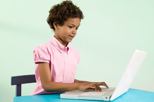 Stock Photo: 1530R-36651 Young girl typing on laptop