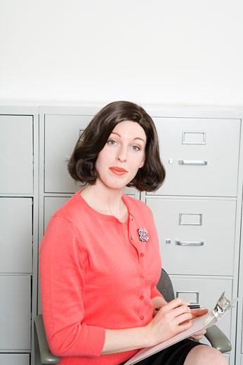 Portrait of businesswoman taking notes : Stock Photo