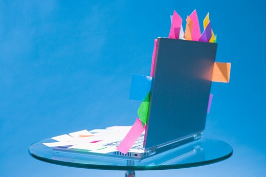 Laptop with sticky notes stuck to it : Stock Photo