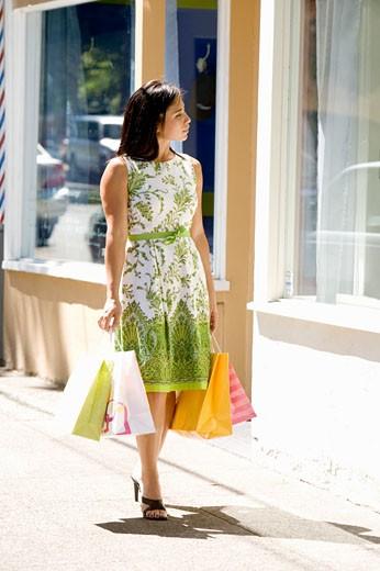 Woman window-shopping : Stock Photo