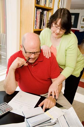 Couple paying bills : Stock Photo
