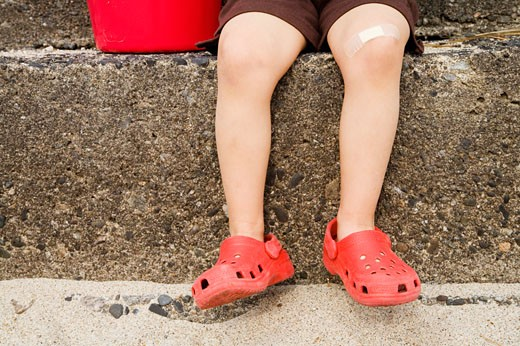 Close up of young boy's legs on steps : Stock Photo