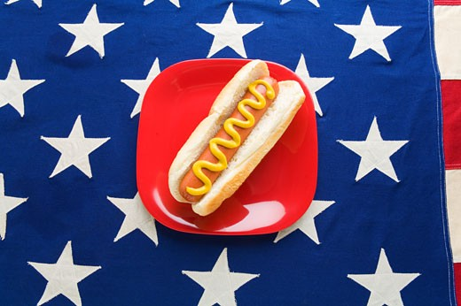 Hot dog on American flag tablecloth : Stock Photo
