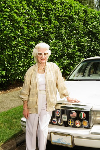 Stock Photo: 1530R-38721 Senior woman leaning on car