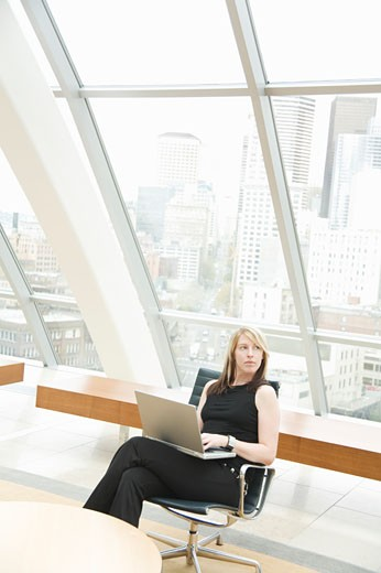 Businesswoman typing on laptop : Stock Photo