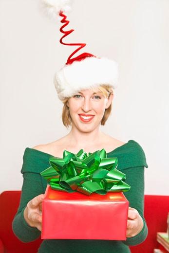 Woman holding Christmas gift : Stock Photo
