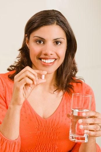 Woman taking vitamin : Stock Photo