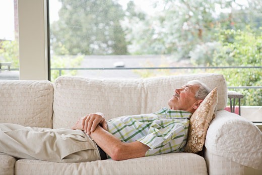 Stock Photo: 1530R-39848 Man napping on a couch