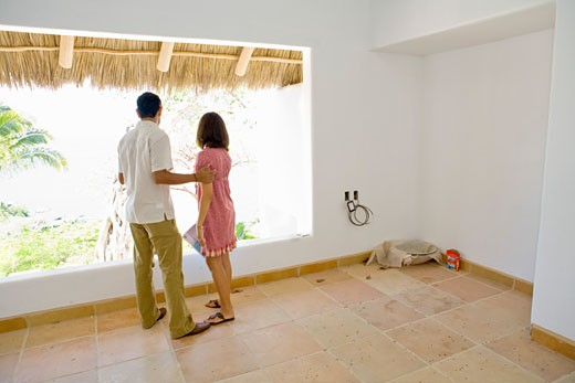 Stock Photo: 1530R-39960 Couple looking through a window