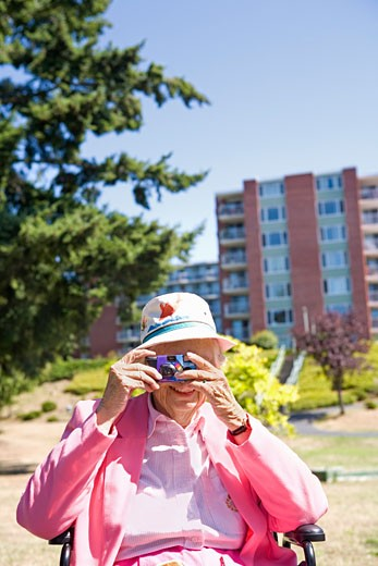 Stock Photo: 1530R-40061 Woman photographing with a digital camera