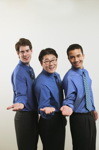 Stock Photo: 1530R-4013 Studio portrait of three businessmen in blue shirts.