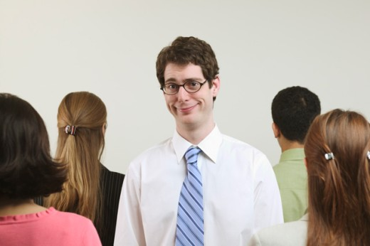 Stock Photo: 1530R-4020 A young, tall businessman surrounded by four colleagues.