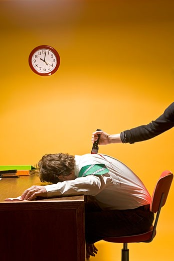 Stock Photo: 1530R-40398 Man in office being stabbed in the back