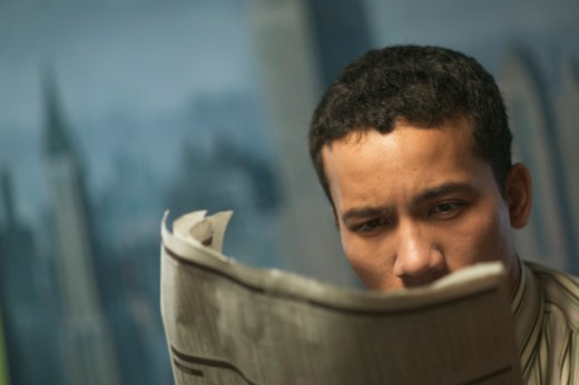 Young businessman reading the newspaper.   : Stock Photo